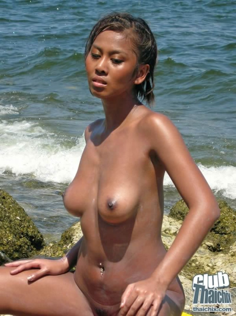 Tanned skinned beauty shows off her perfect pink pussy 4